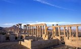 """The Arab castle, Qala'at Ibn Maan (also known as Fakhr-al-Din al-Maani), situated on a hill overlooking the ruins was orignally constructed by the Mamluks in the 13th century.<br/><br/>  Palmyra was an ancient city in Syria. It was an important city in central Syria, located in an oasis 215 km northeast of Damascus and 180 km southwest of the Euphrates at Deir ez-Zor. It had long been a vital caravan city for travellers crossing the Syrian desert and was known as the Bride of the Desert. The earliest documented reference to the city by its Semitic name Tadmor, Tadmur or Tudmur (which means """"the town that repels"""" in Amorite and """"the indomitable town"""" in Aramaic) is recorded in Babylonian tablets found in Mari."""